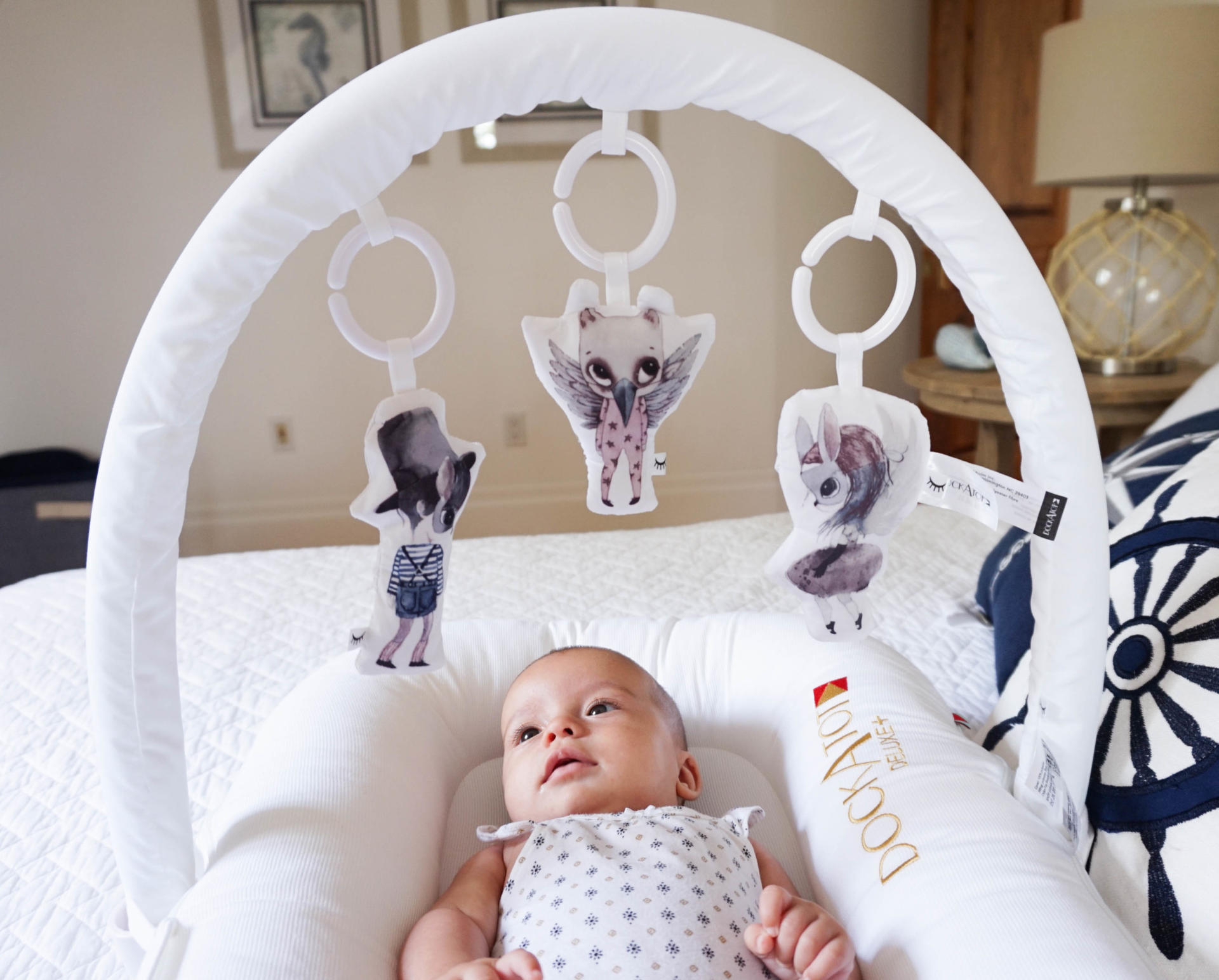 DockATot Toy Arch Hanging toys